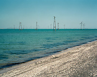 Metal structures for the oil industry litter the Caspian Sea off the Azeri coast.