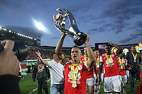 BOGOTA, COLOMBIA - January- 29-2017:  Anderson Plata Player of Independiente Santa Fe  raises the championship trophy of the National League Aguila 2017  celebrate their  victory against of Independiente Medellin and win the National Super League Aguila 2017 during a match between Independiente Santa Fe and Independiente Medellin as part of National Super League Aguila 2017 match played  at Nemesio  Camacho El Campin Stadium on January 29, 2016 in Bogota, Colombia.   Photo by Felipe Caicedo/ VizzorImage / Staff