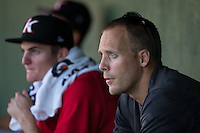 Kannapolis Intimidators conditioning coach Bret Kelly and starting pitcher Jimmy Lambert (8) watch the action from the dugout during the game against the Greensboro Grasshoppers at Intimidators Stadium on July 17, 2016 in Greensboro, North Carolina.  The Grasshoppers defeated the Intimidators 5-4 in game two of a double-header.  (Brian Westerholt/Four Seam Images)