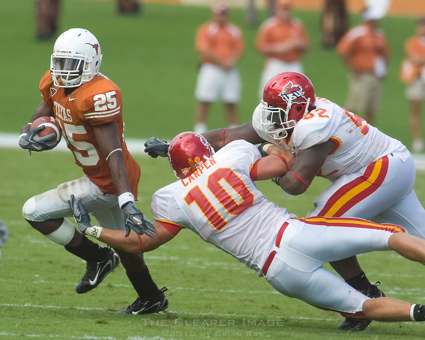 23 September 2006: Texas back Jamaal Charles (#25) beats Iowa State defenders Adam Carper (#10) and Brent Curvey around the end during the Longhorns game against the Iowa State Cyclones at Darrell K Royal Memorial Stadium in Austin, TX.