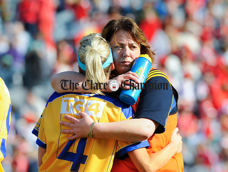 Clare manager Deirdre Murphy consoles Michelle Delaney after being beaten by Tipperary during the closing moments of the Intermediate Ladies Football final at Croke Park. Photograph by John Kelly.