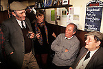 Local men  recite stories and poetry. Kings Head Laxfield Suffolk England.
