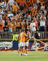 Houston Dynamo midfielder Stuart holden (22), midfielder Brad Davis (11), and forward Kei Kamara (10) celebrate a goal.  Houston Dynamo defeated FC Dallas 1-0 at Robertson Stadium in Houston, TX on May 9, 2009
