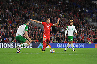 Shane Duffy of Republic of Ireland vies for possession with Aaron Ramsey of Wales during the UEFA Nations League B match between Wales and Ireland at Cardiff City Stadium in Cardiff, Wales, UK.September 6, 2018