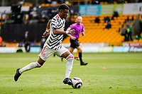 23rd May 2021; Molineux Stadium, Wolverhampton, West Midlands, England; English Premier League Football, Wolverhampton Wanderers versus Manchester United; Amad Diallo of Manchester United runs into midfield with the ball