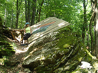 Expert riders get a thrill on features such as this jump that's not for the faint of heart. SueEllen Novick takes a break from the pedals on June 11 2021 to check it out.<br />(NWA Democrat-Gazette/Flip Putthoff)