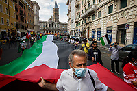 Dr. Yousef Salman, President of the Palestinian Community of Rome and Lazio.<br /> <br /> Rome, Italy. 22nd May 2021. Today, the Trade Union USB, Potere Al Popolo Party, Rifondazione Comunista Party, Palestinian Community of Rome (Comunità Palestinese di Roma e Lazio) and other organizations of the non-parliamentarian Left held a march from Piazza della Repubblica to Piazza San Giovanni:<br /> - to protest against the Global Health G20 summit held in Rome; <br /> - to protest against the alleged capitalist/neo-liberalist management of the pandemic Covid-19/Coronavirus vaccines; <br /> - to protest against alleged multinationals' speculations and their various interests in the pharmaceutical industry;<br /> - To scrap Vaccines' patents (brevetti); <br /> - to call for an Universal Basic Income, proper policies protecting workers and their jobs, and do not let multinationals to cut jobs and factories;<br /> - in Support and Solidarity with Palestine. In 15 days of Israeli bombings, the Gaza Strip alone has suffered the death of at least 248 people - including 66 children -, 1,900+ wounded, and 72,000+ people displaced.<br /> Moreover, protesters called for free vaccines for the whole world population and that every State could have the opportunity to produce them autonomously throughout the nationalization of the pharmaceutical factories.