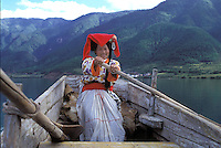 "A Mosuo lady who earns a living rowing tourists on the beautiful Lugu lake in Yunnan. Women from the Mosuo tribe do not marry, take as many lovers as they wish and have no word for ""father"" or ""husband"". But the arrival of tourism and the sex industry is changing their culture...PHOTO BY SINOPIX"
