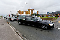 "Pictured: The funeral cortege arrives at Aberavon Beach Hotel in Port Talbot, Wales, UK. Monday 08 October 218<br /> Re: A grieving father will mourners on horseback at the funeral of his ""wonderful"" son who killed himself after being bullied at school.<br /> Talented young horse rider Bradley John, 14, was found hanged in the school toilets by his younger sister Danielle.<br /> Their father, farmer Byron John, 53, asked the local riding community to wear their smart hunting gear at Bradley's funeral.<br /> Police are investigating Bradley's death at the 500-pupils St John Lloyd Roman Catholic school in Llanelli, South Wales.<br /> Bradley's family claim he had been bullied for two years after being diagnosed with Attention Deficit Hyperactivity Disorder.<br /> He went missing during lessons and was found in the toilet cubicle by his sister Danielle, 12."