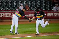Erie Piñatas manager Mike Rabelo (58) congratulates Isaac Paredes (18) as he rounds the bases after hitting a home run during an Eastern League game against the Las Ardillas Voladoras de Richmond on August 28, 2019 at UPMC Park in Erie, Pennsylvania.  Richmond defeated Erie 4-3 in the second game of a doubleheader.  (Mike Janes/Four Seam Images)