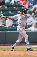 Patrick Norris #23 of the Wilmington Blue Rocks follows through on his swing against the Winston-Salem Dash at the BB&T Park April25, 2010, in Winston-Salem, North Carolina.  Photo by Brian Westerholt / Four Seam Images