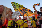 In the ancient marketplace in Dortmund fans celebrate a party because of the title win of their favorite soccer club BVB 09 in the German Premium League. Here they are wavings flags, scarfs and the replica of the championship shield.