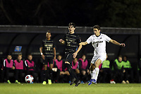 WINSTON-SALEM, NC - DECEMBER 01: Isaiah Parente #15 of Wake Forest University kicks the ball away from Carlos Tellez #6 of the University of Michigan during a game between Michigan and Wake Forest at W. Dennie Spry Stadium on December 01, 2019 in Winston-Salem, North Carolina.
