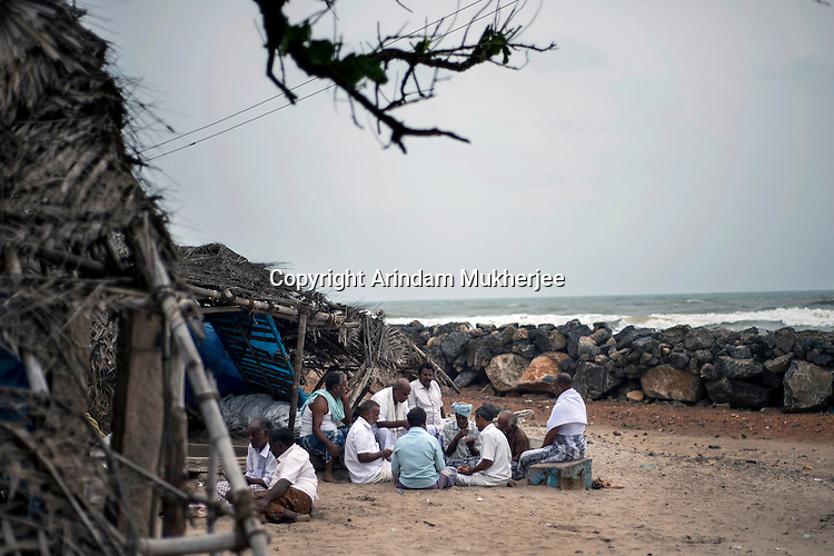 Fishermen playing cards at kichankuppam beach in Nagapattinam. This was one of the most affected areas by 2004 Tsunami in Tamil Nadu, India.