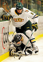 5 February 2011: University of Vermont Catamount defenseman Arthur Griem, a Freshman from Grosse Pointe Shores, MI, checks Providence College Friar left wing forward Jordan Kremyr, a Senior from Cloverdale, B.C. during a game at Gutterson Fieldhouse in Burlington, Vermont. The Catamounts defeated the Friars 7-1 in the second game of their weekend series. Mandatory Credit: Ed Wolfstein Photo