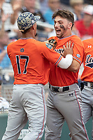 Auburn Tigers third baseman Edouard Julien (10) celebrates after scoring during Game 4 of the NCAA College World Series against the Mississippi State Bulldogs on June 16, 2019 at TD Ameritrade Park in Omaha, Nebraska. Mississippi State defeated Auburn 5-4. (Andrew Woolley/Four Seam Images)