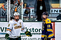 26 January 2019: University of Vermont Catamount Defenseman Matt O'Donnell, a Junior from Fountain Valley, CA and Merrimack College Warrior Forward Michael Babcock, a Senior from Northville, MI, await a referee review in the third period at Gutterson Fieldhouse in Burlington, Vermont. The Warriors fell to the Catamounts 4-3 in overtime after tying up the game in the dyeing seconds of the third period of their America East conference game. Mandatory Credit: Ed Wolfstein Photo *** RAW (NEF) Image File Available ***