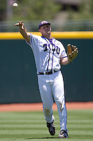 Outfielder Jerrick Suiter #31 of the Texas Christian University Horned Frogs throws the ball during the NCAA Regional baseball game against the Ole Miss Rebels on June 1, 2012 at Blue Bell Park in College Station, Texas. Ole Miss defeated TCU 6-2. (Andrew Woolley/Four Seam Images)