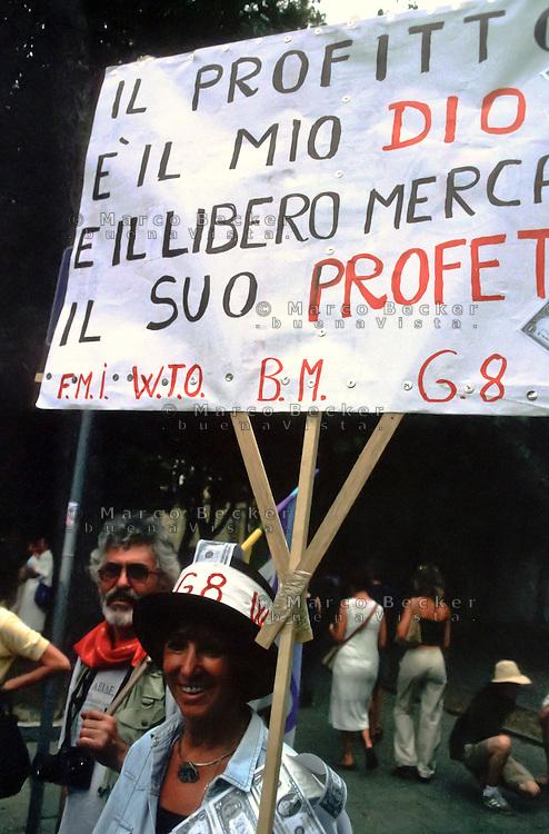 """genova luglio 2001, proteste contro il g8. """"il profitto è il mio dio e il libero mercato il suo profeta"""" --- genoa july 2001, protests against g8 summit. """"profit is my god, free market his prophet"""""""