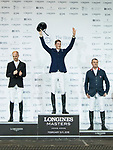 Daniel Deusser of Germany riding Cornet D'Amour celebrates winning, with second placed Jérôme Guery of Belgium riding Garfield de Tiji des Templiers and and third placed Robert Smith of Great Britain riding Ilton competes at the Hong Kong Jockey Club Trophy during the Longines Masters of Hong Kong at AsiaWorld-Expo on 09 February 2018, in Hong Kong, Hong Kong. Photo by Diego Gonzalez / Power Sport Images