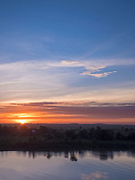Sunrise and the Bassac River this river is a  distributary of the Tonlé Sap and Mekong River River from a Bridge in Phnom Penh, Cambodia, sky, moody, colourful, colorful,