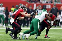10th October 2021; Tottenham Hotspur stadium, London, England; NFL UK Series, Atlanta Falcons versus New York Jets: Atlanta Falcons Running back Mike Davis (28) is tackled by New York Jets Defensive linesman John Franklin-Myers (91)