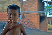 Portrait of a boy in rural area near a brick kiln, Battambang Cambodia