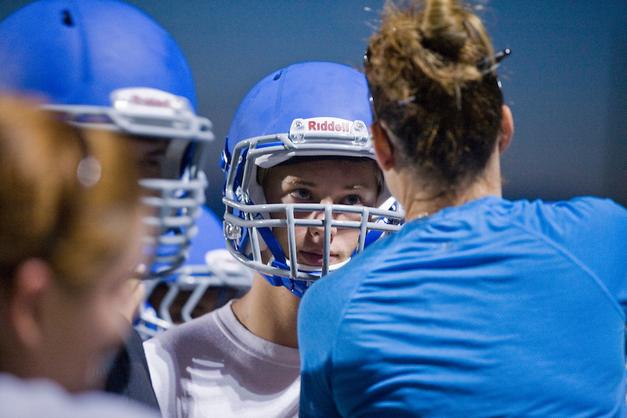 MAE GAMMINO/SPECIAL TO SCRIPPS TREASURE COAST NEWSPAPERS<br /> <br /> Players line up for helmet adjustments before the first day of practice for Sebastian River High School football.