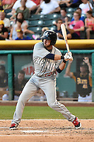 Mike Freeman (12) of the Reno Aces at bat against the Salt Lake Bees in Pacific Coast League action at Smith's Ballpark on July 23, 2014 in Salt Lake City, Utah.  (Stephen Smith/Four Seam Images)