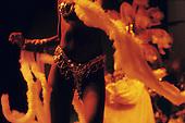 Rio de Janeiro, Brazil. Torso of girl dancing in skimpy sequin bikini with long feathers.