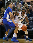 Nevada's Marqueze Coleman dribbles past Air Force defender Hadyen Graham during an NCAA basketball game in Reno, Nev., on Saturday, Feb. 1, 2014. Nevada won 69-56 in overtime. (AP Photo/Cathleen Allison)