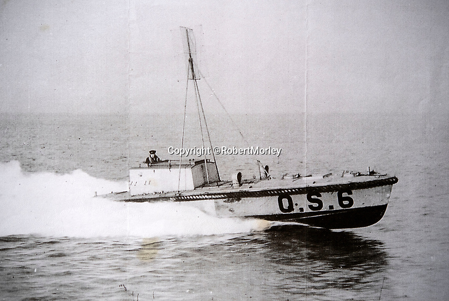 BNPS.co.uk (01202 558833)<br /> Pic: RobertMorley/BNPS<br /> <br /> A similar craft with  the radio reciever mast in place.<br /> <br /> The world's first drone boat is rediscovered - after 100 years in the shadows.<br /> <br /> A historic British torpedo boat, which was converted into the world's first remotely controlled 'drone vessel' as part of a top secret project at the end of the Great War has been painstakingly researched and restored after being discovered rotting in a West country boatyard.<br /> <br /> The pioneering CMB9/DCB1 was one of 12 Coastal Motor Boats (CMBs) built by the Admiralty in 1916 to target German destroyers.<br /> <br /> The fast, lightweight 40ft motor torpedo boat, which could travel at 40 knots, sunk the German destroyer G88 off Zebrugge in Belgium in 1917.<br /> <br /> Subsequently, it was one of four vessels converted into Distance Control Boats (DCBs) for top secret trials to see if unmanned patrol boats with torpedoes could be radio controlled via aircraft and directed towards enemy targets.<br /> <br /> The boat was found in a sorry state covered in brambles in a boat yard in Weston-super-Mare, Somerset, by marine surveyor Robert Morley a decade ago, who has spent tens of thousands of pounds restoring and researching it's colourful history.