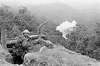 A 120mm mortar shell explodes at the beginning of the second battle for Ember Hill. The All Burma Students Democratic Front (ABSDF) soldier was one of four young men who joined the student army after being forced to porter for the Burma Army. They escaped by fleeing across minefields. He was later killed in action, fighting soldiers of the Karenni National People's Liberation Front.