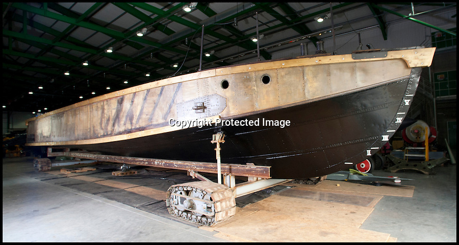 BNPS.co.uk (01202 558833)<br /> Pic: LauraJones/BNPS<br /> <br /> Worlds first Aircraft Carrier restored.<br /> <br /> An amazing tale of bravery and ingenuity from the First World War has been revealed as the worlds first aircraft carrier has been restored at the Fleet air arm museum in Somerset.<br /> <br /> Measuring just 58ft long, the precarious craft was invented to counter the threat of Zepplin raids over London and enabled a plucky pilot to launch his Sopwith Camel at the enemy from the North sea before the feared airships could reach Britain.<br /> <br /> The tiny carriers were towed out from port behind a battleship with the aircraft strapped to the top of a wooden ramp. The crew and pilot would have to endure the conditions before an enemy was spotted and the ship then towed them into wind as fast as they could.<br /> <br /> The pilot had just 58ft of 'runway' to get the plane airborne or it would plummet into the sea with disastrous consequences.<br /> <br /> A team of seamen had to hold the plane back while the pilot got the engine up to speed then release the chocks at the right moment.<br /> <br /> Incredibly even if the plane made it into the air, the only way the pilot could land again was by crashing into the sea in the hope of being rescued.