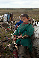 Bovanenkovo ,Yamal Peninsula, Russia, 09/07/2010..A Nenets boy with his hunting bow at an overnight camp as the indigenous nomadic reindeer herders head north on sledges to the Russian Arctic coast.