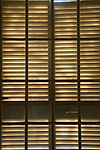 Pattern from light through wooden window shutters. Tuscany Italy. 2010