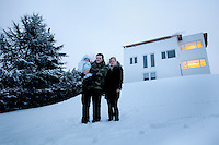 Cecilie stands in the snow with her husband and son outside their house in Gentofte. Cecilie was the legal guardian of Nepalese orphan Victoria. 19 month old Victoria (formerly named Ghane) was born with hydrocephalus and was left abandoned. Cecilie Hansen was so moved by the story of Ghane she read in a Danish newspaper that she decided to fly to Kathmandu to try to assist her and show her the love of another human being; Cecilie eventually became her legal guardian. Victoria died on November 19 2010 from heart failure. A week after Cecilie's return to Denmark she got a text message from the surgeon reading: 'Dear Cecilie. Be brave. You tried. We all tried. It was her fate. Please try to find peace.'