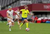 TOKYO, JAPAN - JULY 21: Kosovare Asllani #9 of Sweden dribbles during a game between Sweden and USWNT at Tokyo Stadium on July 21, 2021 in Tokyo, Japan.