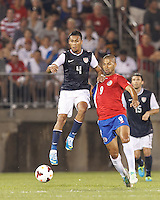 USMNT defender Michael Orozco (4) and Costa Rican substitute forward Alvaro Saborio (9) battle for the ball.  In CONCACAF Gold Cup Group Stage, the U.S. Men's National Team (USMNT) (blue/white) defeated Costa Rica (red/blue), 1-0, at Rentschler Field, East Hartford, CT on July 16, 2013.