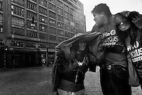 Young Colombians (the Antanas Mockus fans) caught in the rain in the center of Bogota, Colombia, 23 May 2010.