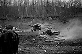 Machine Gun Shoot<br /> Knob Creek<br /> Westpoint, Kentucky<br /> USA<br /> April 3, 2009<br /> <br /> Nearly 16,000 people attend the Knob Creek Machine Gun Shoot & Military Gun Show. It is the largest gathering of Civilian owned machine guns in the world. The gun show has over 700 tables with machine guns, military surplus, ammo, hard to find parts & pieces and regular firearms and supplies.<br /> <br /> Firearms sales have surged in the six months since Obama's election as millions of Americans have gone on a buying spree that has stripped gun shops in some parts of the country almost bare of assault weapons and led to a national ammunition shortage.<br /> <br /> The FBI says that since November more than seven million people applied for criminal background checks in order to buy weapons, a figure excluding the many more buying at thousands of gun shows in states such as Virginia, without facing any checks.<br /> <br /> Gun-shop owners and the National Rifle Association say the surge is driven by worries that Obama is planning to ban many types of firearms and that the deepening economic crisis will fuel a crime wave, as witnessed by the string of mass shootings in the past few weeks.<br /> <br /> But control groups pressing for greater control on firearms accuse the NRA of funding a massive scare campaign to portray Obama as a gun owner's worst nightmare and to argue that tighter restrictions on weapons ownership are a threat to broader liberties and a step toward tyranny.