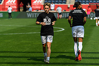 BRIDGEVIEW, IL - JULY 18: Jessica Fishlock #10 of the OL Reign warms up before a game between OL Reign and Chicago Red Stars at SeatGeek Stadium on July 18, 2021 in Bridgeview, Illinois.