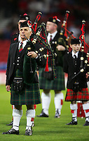 A Scottish bagpipe band on the pitch for the national anthems