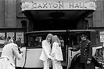 Caxton Hall, Westminster London. Londons main register office until 1979. White wedding, his and her uni sex clothes, she is wearing a trouser suit. rather than a wedding dress, very fashionable at that time. 1970s London ..<br /> He is Michael Stephens I think a well know hairdresser of the time. If you know otherwise please let me know.
