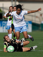 07 June 2009: Chioma Igwe of the Red Stars trips over Leslie Osborne of the Gold Pride during the game at Buck Shaw Stadium in Santa Clara, California.   FC Gold Pride tied Chicago Red Stars, 1-1.
