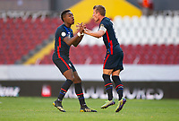 GUADALAJARA, MEXICO - MARCH 28: Jackson Yueill #6 of the United States celebrating his goal with team mate Andres Perea #15 during a game between Honduras and USMNT U-23 at Estadio Jalisco on March 28, 2021 in Guadalajara, Mexico.
