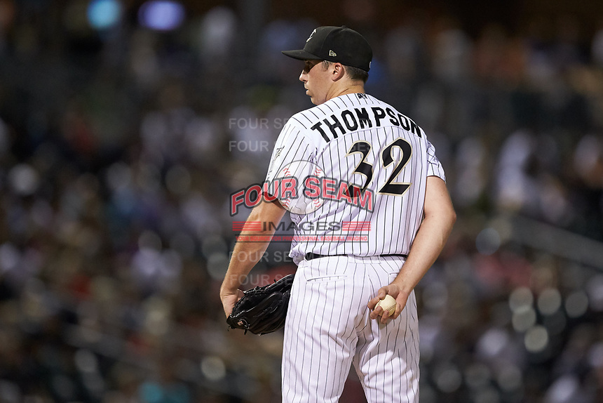 Charlotte Knights relief pitcher Zach Thompson (32) looks to his catcher for the sign against the Gwinnett Braves at BB&T BallPark on July 12, 2019 in Charlotte, North Carolina. The Stripers defeated the Knights 9-3. (Brian Westerholt/Four Seam Images)
