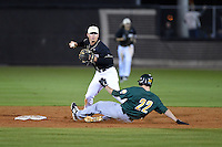 UCF Knights infielder Dylan Moore (2) attempts to turn a double play as Dan Swain (22) slides in during the opening game of the season against the Siena Saints on February 13, 2015 at Jay Bergman Field in Orlando, Florida.  UCF defeated Siena 4-1.  (Mike Janes/Four Seam Images)