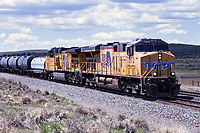 Union Pacific Locomotive 7372, a model GE AC45CCTE, leads an eastbound freight towards Evanston, Wyoming.