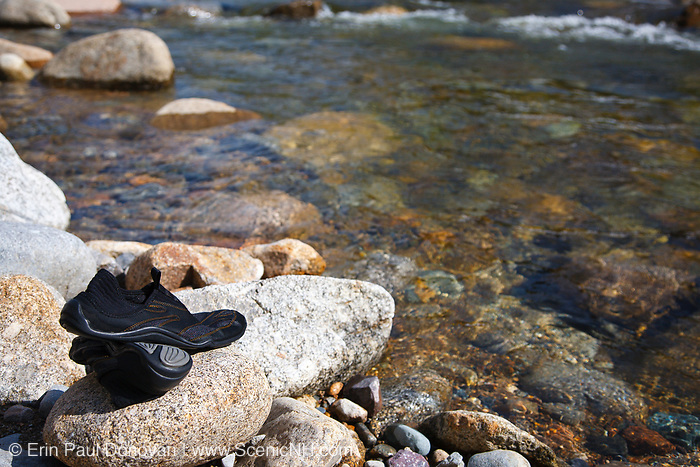 Water shoes on rocks along the East Branch of the Pemigewasset River in the Pemigewasset Wilderness of Lincoln, New Hampshire USA.